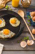 Eggs fried rustic style Stock Photos