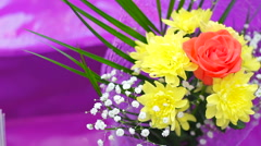 Beautiful bright flowers in bouquet roses, chrysanthemum - stock footage