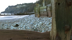 Pebble beach at low tide - stock footage