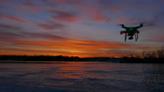 Peaceful sunrise is disrupted when a speeding drone flying through - stock footage