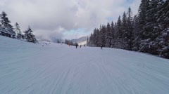 Winter mountains view, POV. Riders on pistes of alpine skiing resort. Stock Footage