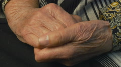 Senior woman massages painful hands - stock footage