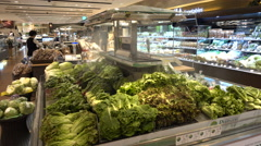 Fresh vegetables for sale in a modern supermarket in Seoul, South Korea Stock Footage