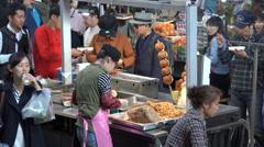 Meat balls, street vendor, busy shopping street, market, Seoul, South Korea Stock Footage