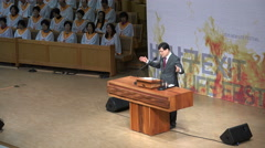 A South Korean priest gives a speech at Sunday mass in a modern church in Seoul Stock Footage