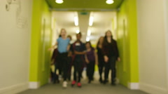 4K Portrait of happy diverse group of children in school hallway - stock footage