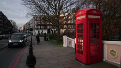 Red phone box in Battersea Park, London, England, Europe Stock Footage
