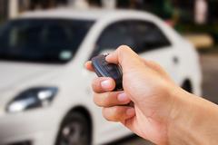 Close up hand holding car key Stock Photos