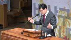 Christianity in Asia, South Korean preacher hold passionate speech in church - stock footage