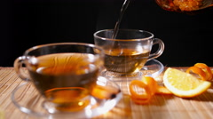 Pouring Blooming Tea with Cinnamon and Orange 2 4K - stock footage