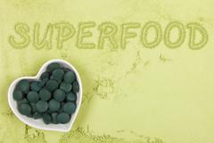 Green food supplement background. - stock photo