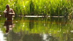 Fisherman catch the fish in the river with Spin fishing - stock footage
