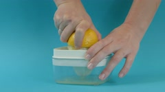 Lemon juicing and squeezing - stock footage