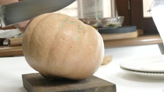 Pumpkin cutting and splitting - stock footage