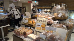 Chefs in bakery shop in popular shopping mall in Seoul, South Korea Stock Footage
