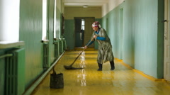 Cleaning woman washing the floor at school Stock Footage