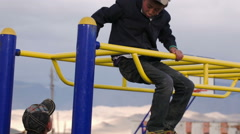 Boy playing, climb the stairs and on the horizontal bar Stock Footage