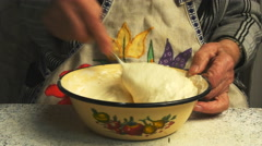 Grandmother kneads the dough Stock Footage