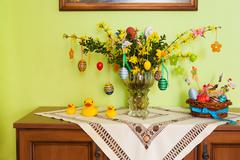Yellow forsythia flowers and easter decoration Stock Photos