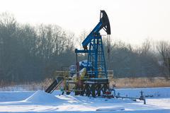 Oil derricks in winter - stock photo