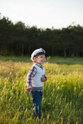 boy captain sailor spring forest funny smile joy laughter kid - stock photo