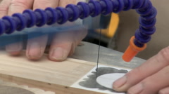 Close up of hands of craftsperson cutting piece of wood Stock Footage