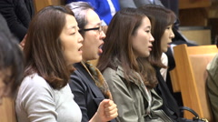 Audience in a church sings Halleluja, upbeat atmosphere, Seoul, South Korea Stock Footage