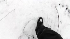Man walks through the snow squeaks under his steps Stock Footage
