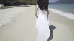 Woman is walking on the beach. - stock footage