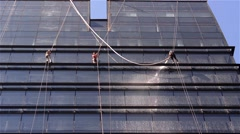 Team of workers that cleans exterior windows of a tower block, they are all down Stock Footage