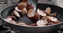 Sauteed mushrooms in pan Stock Footage