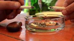 Smokers who flick cigarette ashes of to cigarettes in an ashtray in which the Stock Footage
