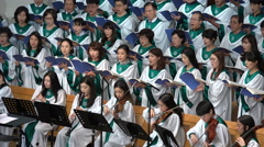 Traditional church choir singing songs, music, gowns, dress, podium, South Korea Stock Footage