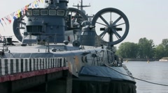 Flying military ship at the pier anchored Stock Footage