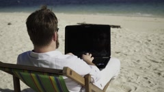 Distant work on the beautiful beach. - stock footage