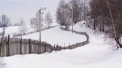 Winter landscape in the forest on a road covered with snow - stock footage