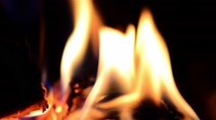 Playful flames. that engulfed a wood put in the stove to warm the cold air in Stock Footage