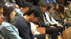 Asian people pray during Sunday mass in a South Korean church Stock Footage