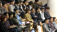 Young and old churchgoers attend Sunday mass in a modern church in Seoul Stock Footage