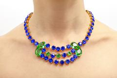luxury gemstone necklace on a woman's neck - stock photo