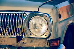 Front round headlight old car in bad condition. - stock photo