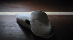 House slippers on wooden floor, dolly out - stock footage