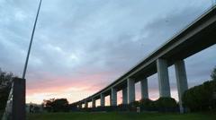 Red orange pink sunset, Vasco da Gama Bridge, Lisbon, Portugal Stock Footage