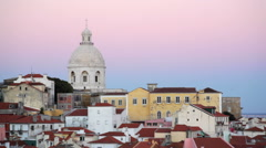 Colorful buildings, pink red sunset, Church of Santa Engrácia, Lisbon, Portugal Stock Footage