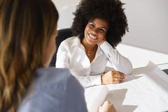 Black Architect Women Talking Plans And Housing Project - stock photo