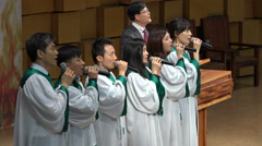 Asian church choir singing gospel music in a Christian church in South Korea Stock Footage