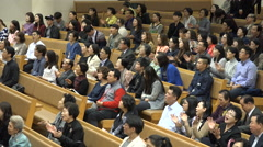 Churchgoers sing Halleluja, clapping, ceremony, Sunday Mass in South Korea Stock Footage