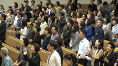 People attending a church mass sing Halleluja in Seoul, South Korea Stock Footage