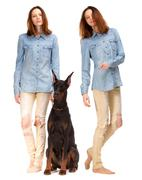 Red girl in jeans with big dog - stock photo
