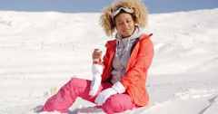 Young woman relaxing in thick winter snow Stock Footage
